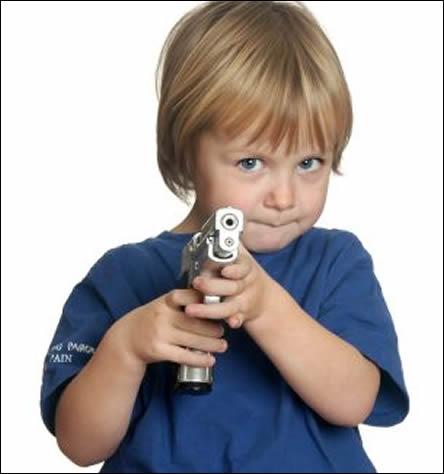 A toddler pointing a gun