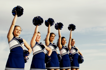 line of girl cheerleaders in blue and white