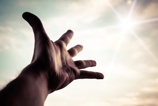 hand raised to sky