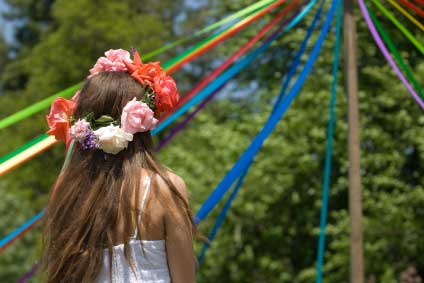 Girl dancing around a may pole