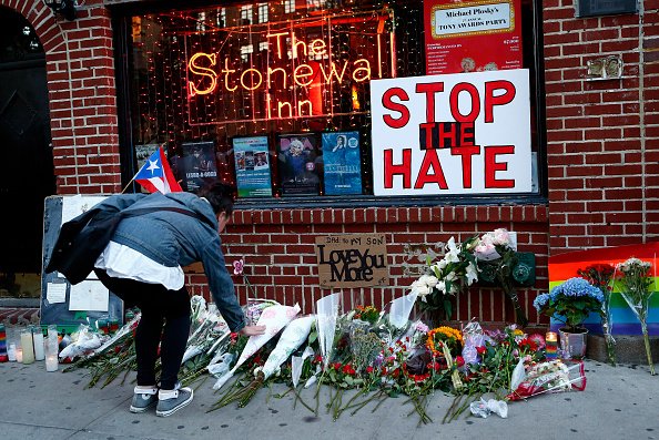 Flowers being placed at a memorial in front of the Stonewall Inn in New York City