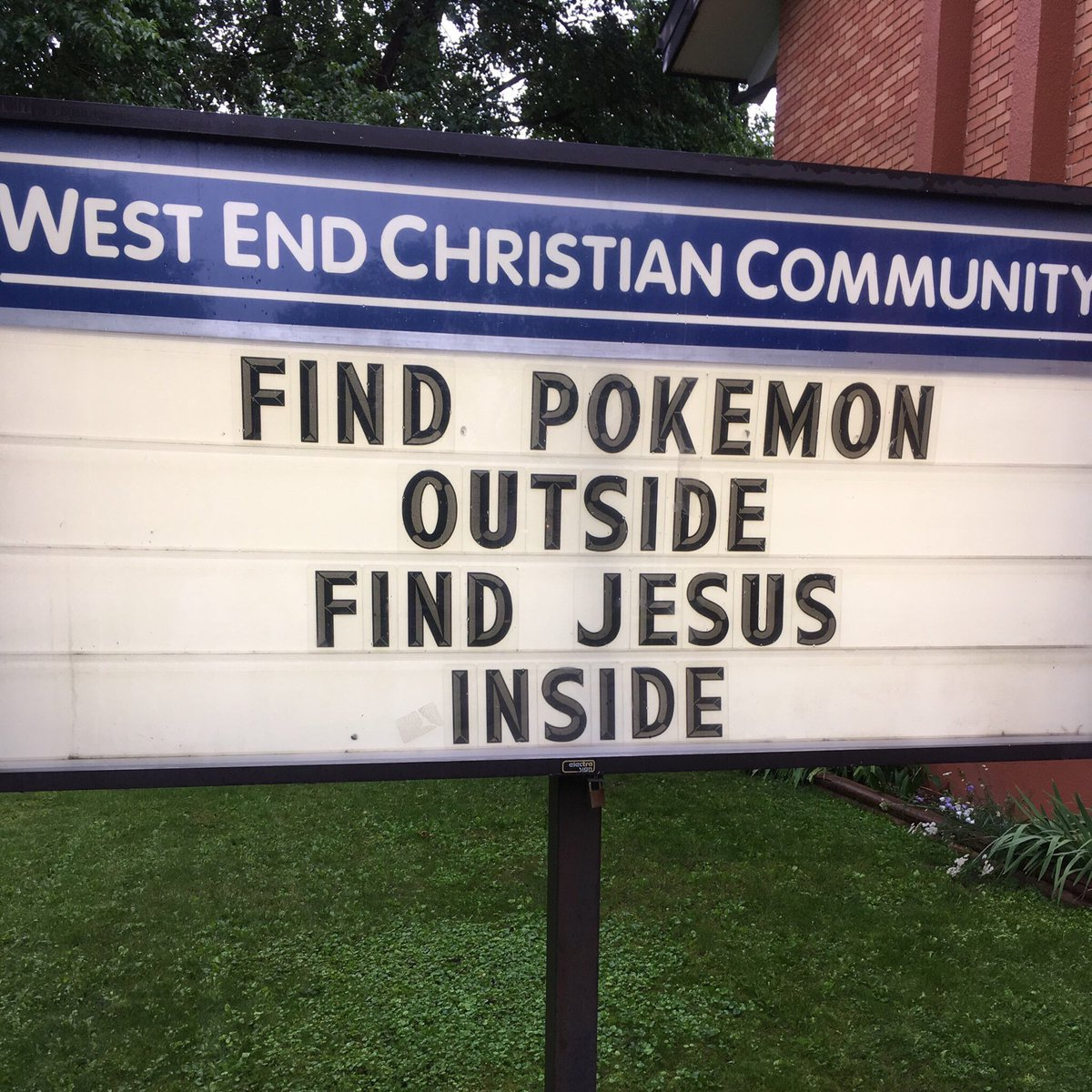 A sign promoting Pokemon outside a church