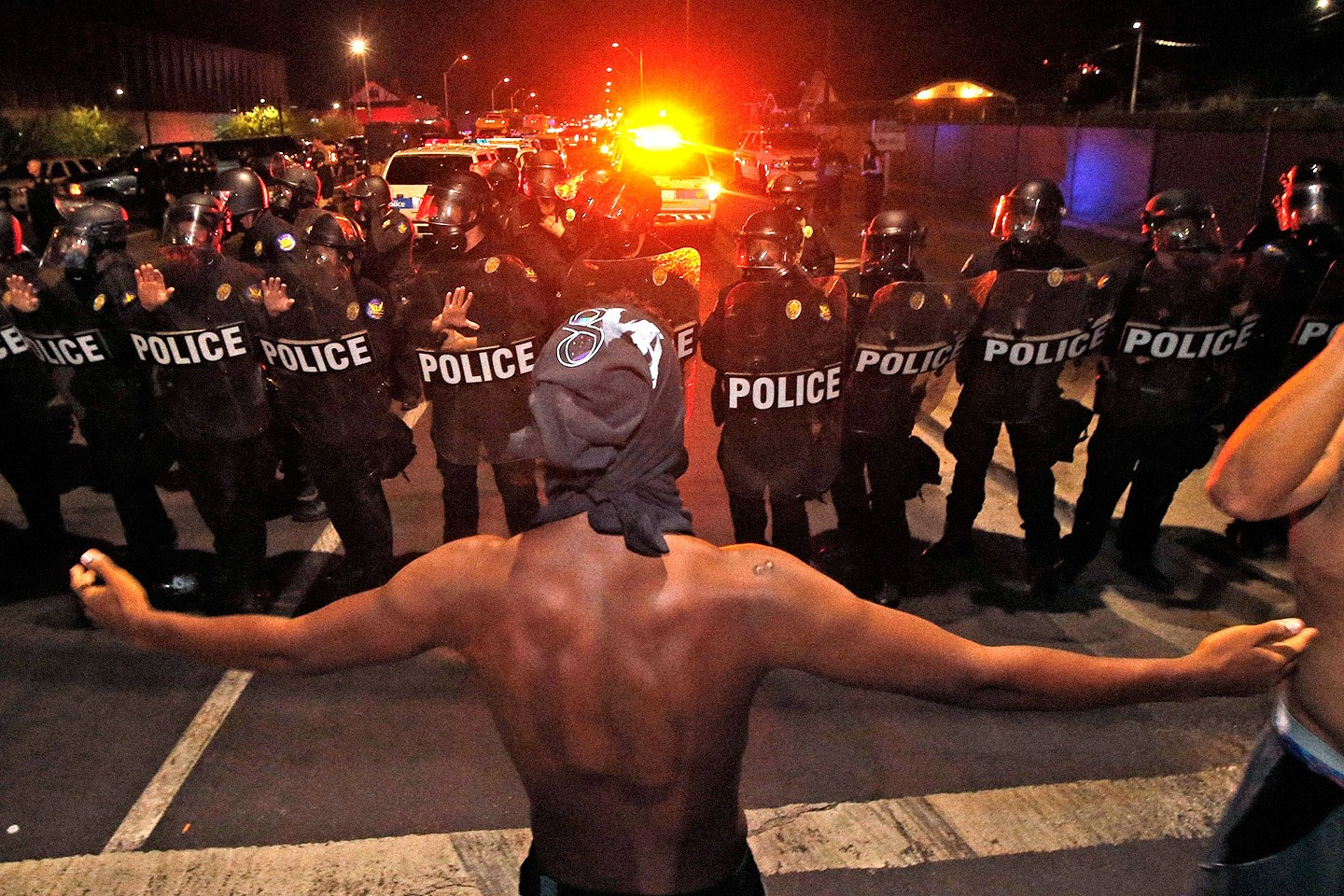 A Black Lives Matter demonstrator faces off against police