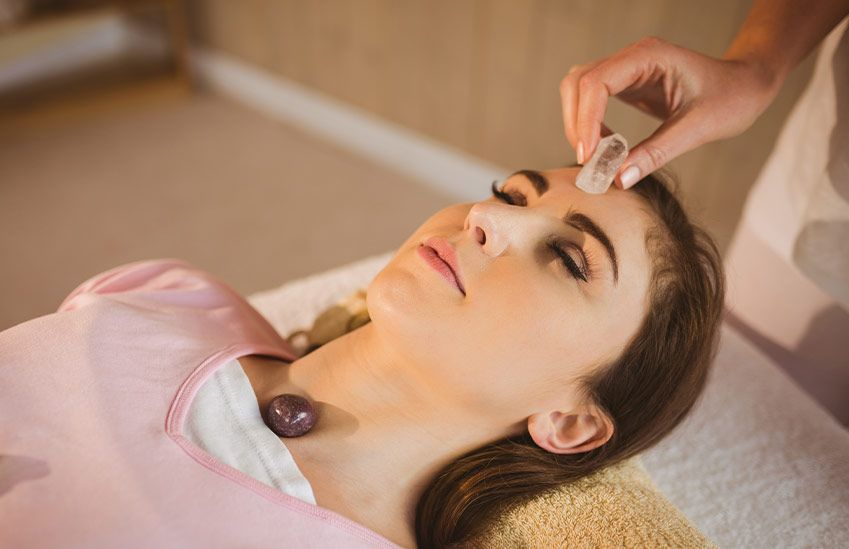 A Woman at a Crystal Healing Session