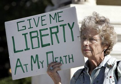 A woman protesting in favor of assisted suicide.
