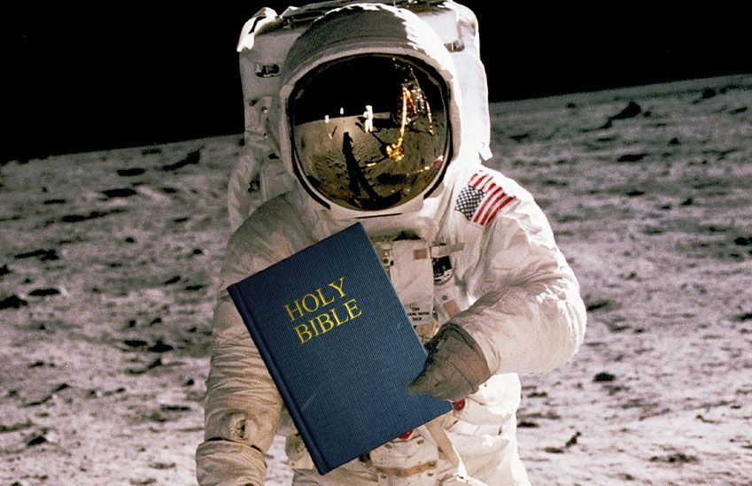 An Astronaut Holding the Holy Bible