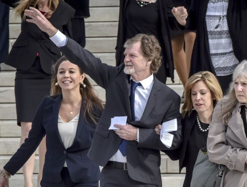 Jack Phillips waves to the crowd outside Supreme Court