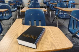 A bible on a classroom desk