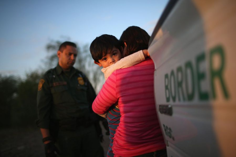A child and mother embracing at the border.