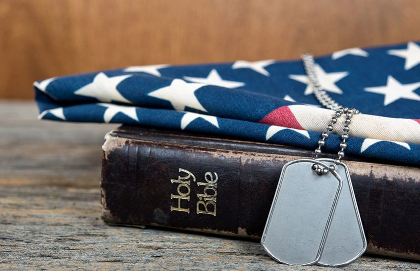 Dog tags resting on the Holy Bible