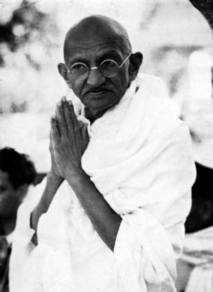 Gandhi demonstrating peaceful solutions