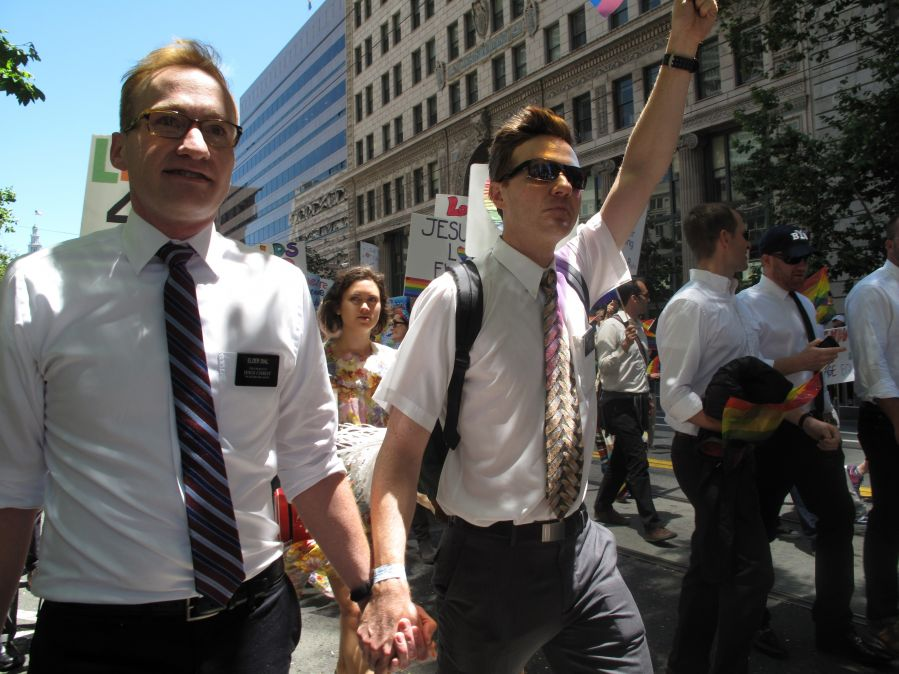 A pair of gay Mormons marching in a parade