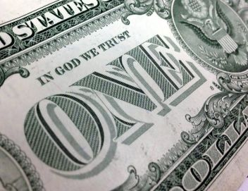 """In God We Trust"" on dollar bill"