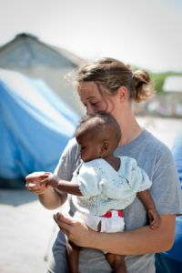 Haitian earthquake aid worker showing compassion