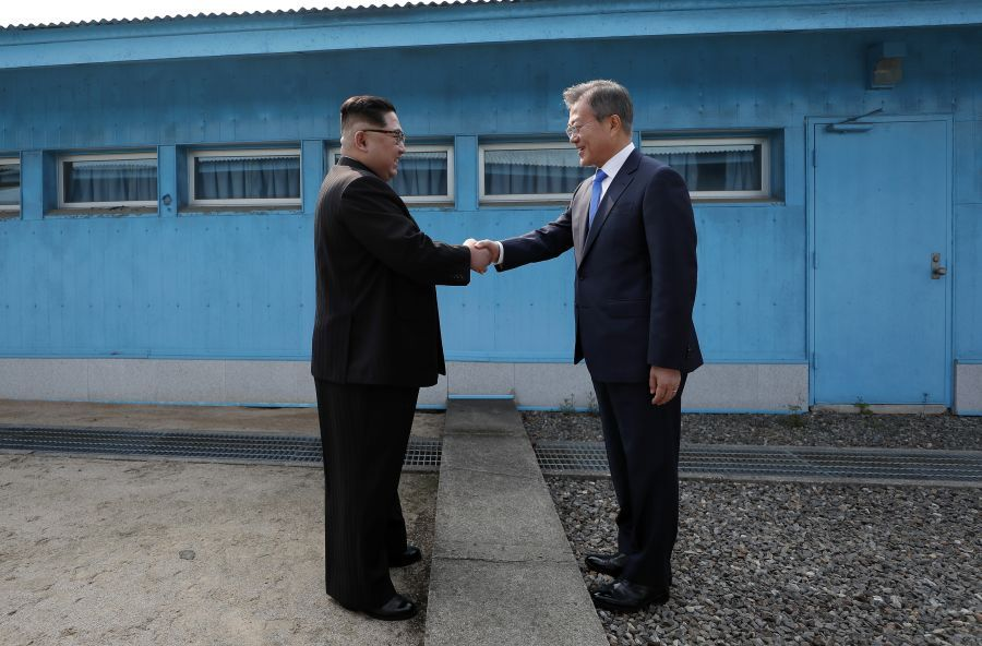 North Korean leader Kim Jong Un shakes hands with South Korean president.