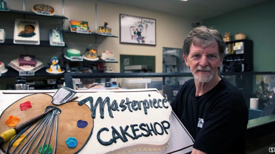 Jack Phillips posing in his cake shop