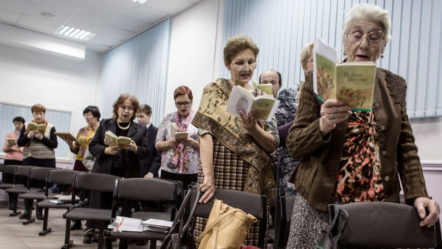 Jehovah's Witnesses sing during a service in Russia.