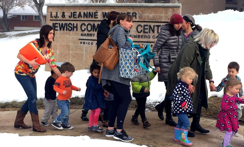 Jewish children evacuating a community center in the wake of bomb threats