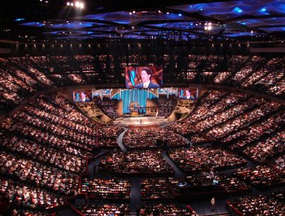 A pastor addresses congregation at megachurch.