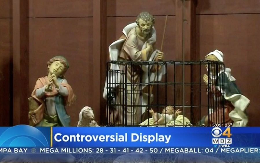 Jesus in a nativity cage