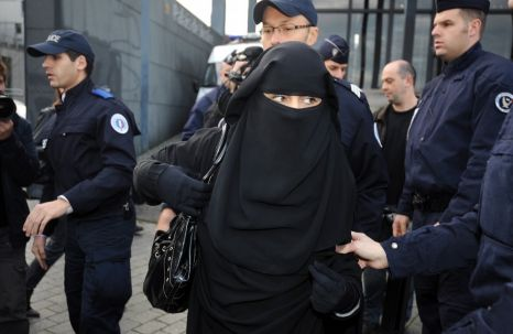 A woman being arrested in France for wearing a niqab