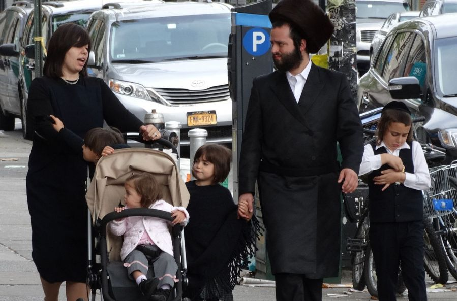 An Orthodox Jewish family walking on the street