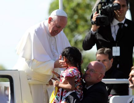 Pope Francis embracing immigration