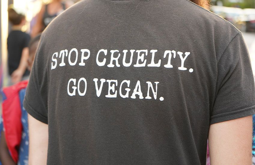 A protester wearing a vegan shirt