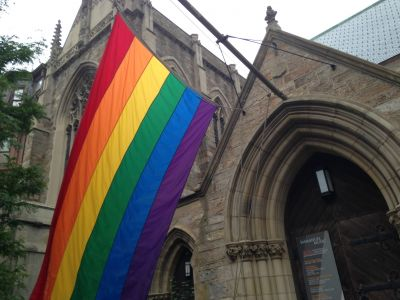 A church flying a rainbow flag