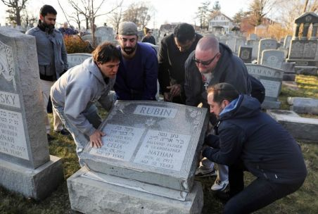 Cemetery vandalism helped to bring faith groups together to repair the damage