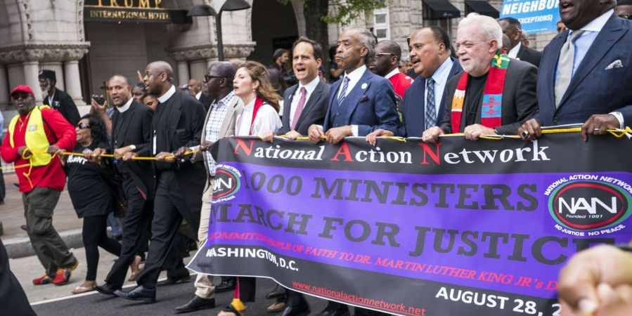 Al Sharpton leads fellow ministers in a march for justice.