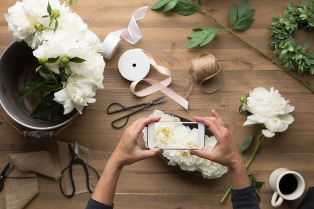 Person taking a photo of wedding decorations