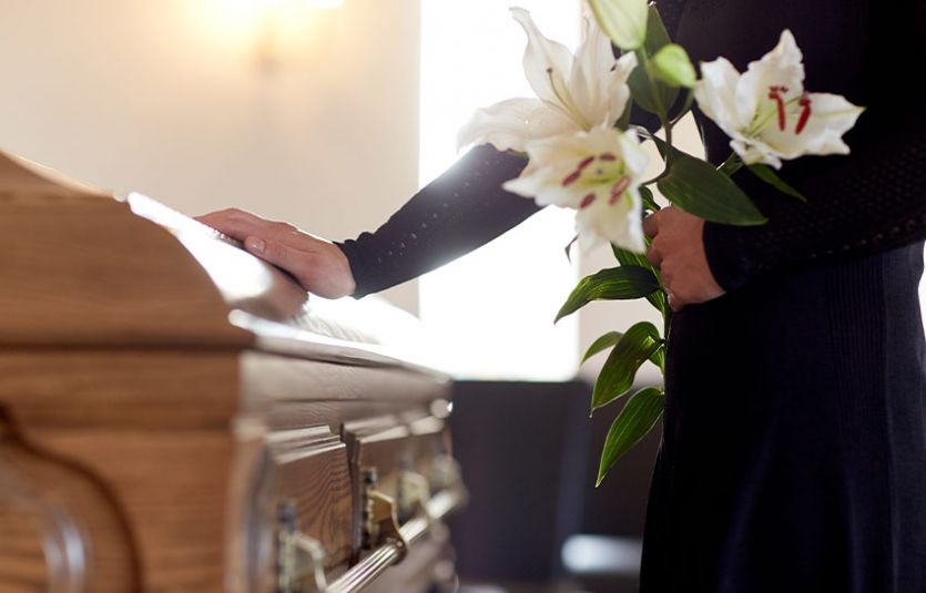 Woman paying respects at funeral