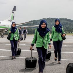 Flying Sharia-Air? Meet the Flight Attendants Required to Wear Hijabs