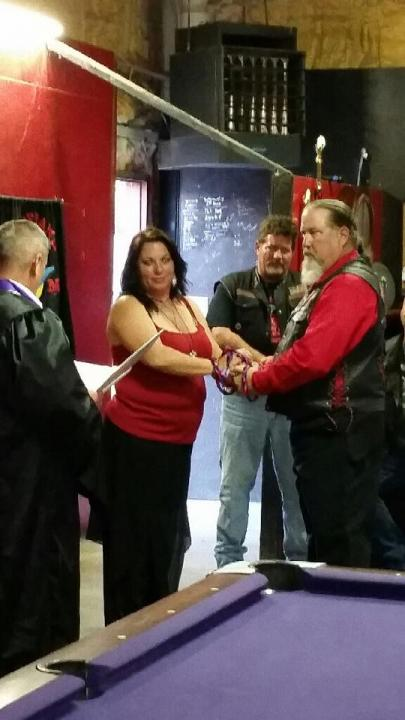 Minister officiates this biker themed wedding.