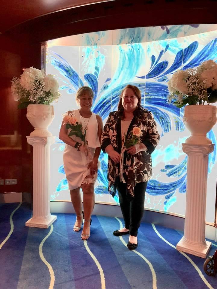 Prior to ceremony, bride and maid of honor in Chapel of the Norwegian Pearl ship.