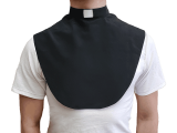 Black clerical dickey from the Universal Life Church. Worn underneath clothes, this garment is used to create a professional clergy image while on a budget.