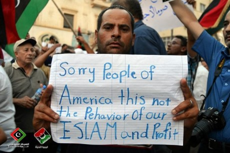 Libyans with signs, sorry people of America, this is not the behavior of our Islam and Prophet